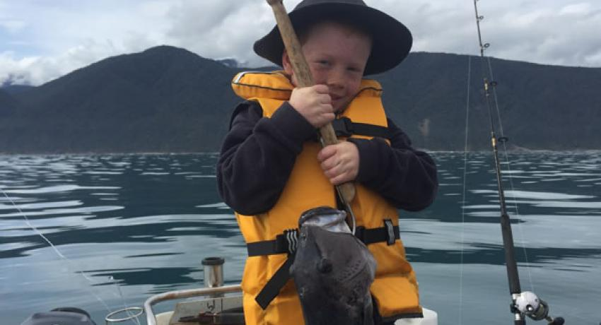 Next generation holding a fish